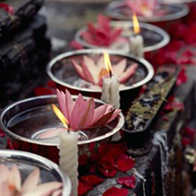 candles burning with flowers